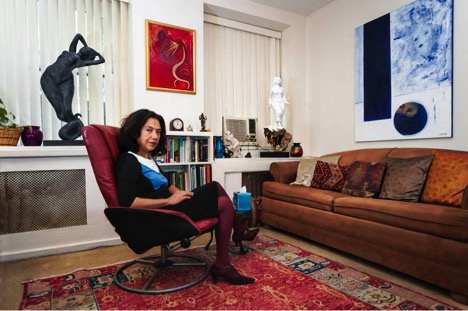 Maria Taveras in her office with examples of her Dream Art sculptures and paintings. This photograph is on page 103 of the book Fifty Shrinks by Sebastian Zimmerman.